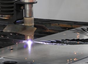 Cutting metal sheet with a laser cutting tool.